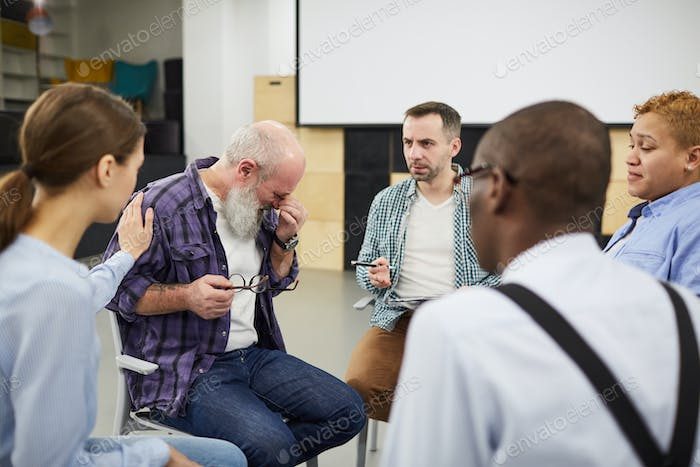 Senior Man Crying in Support Group