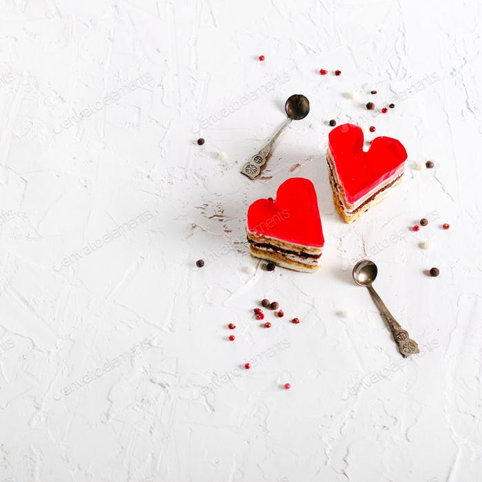 Two jelly heart-shaped cakes on white concrete background. Free space for your text
