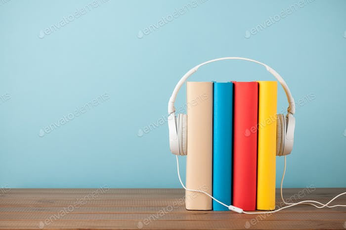 Stack of books with headphones