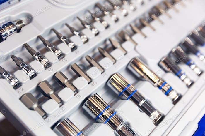 Профессиональный набор инструментов, головки и форсунки крупным планом
