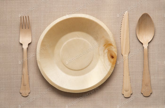 Wooden cutlery and empty clean plate