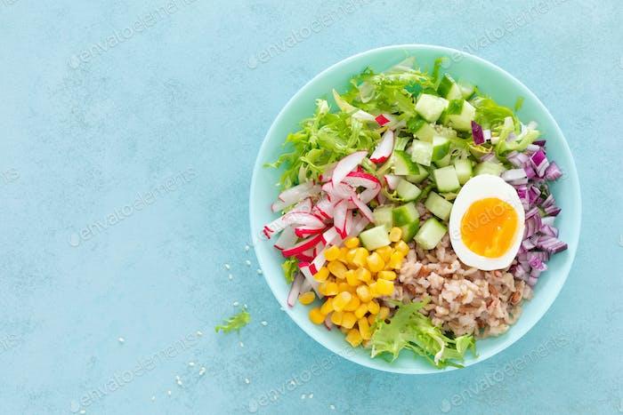 Buddha bowl with boiled egg, rice