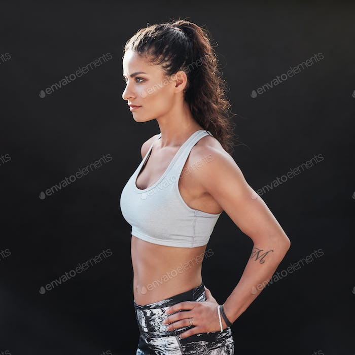 Slim and fit young woman in sportswear