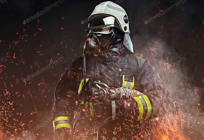 A firefighter dressed in a uniform in a studio.