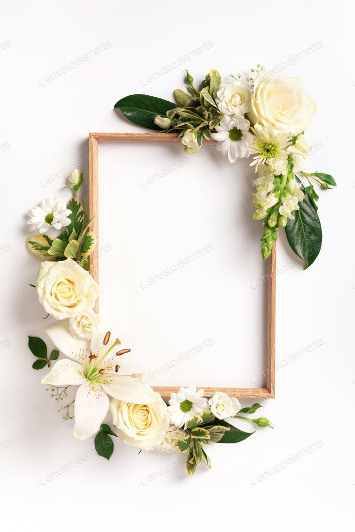Frame of rose, lily, gerbera flowers over white background. Valentines day, Woman day concept