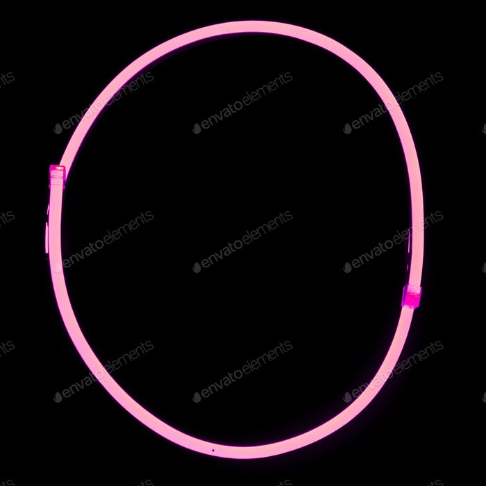 Alphabet pink neon lights on black background