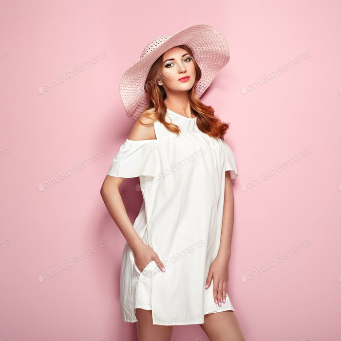 Blonde young woman in summer white dress