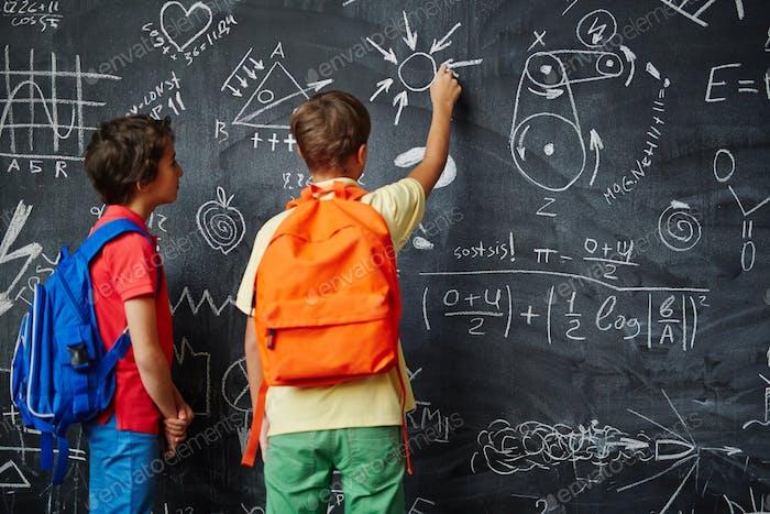 Boys by blackboard