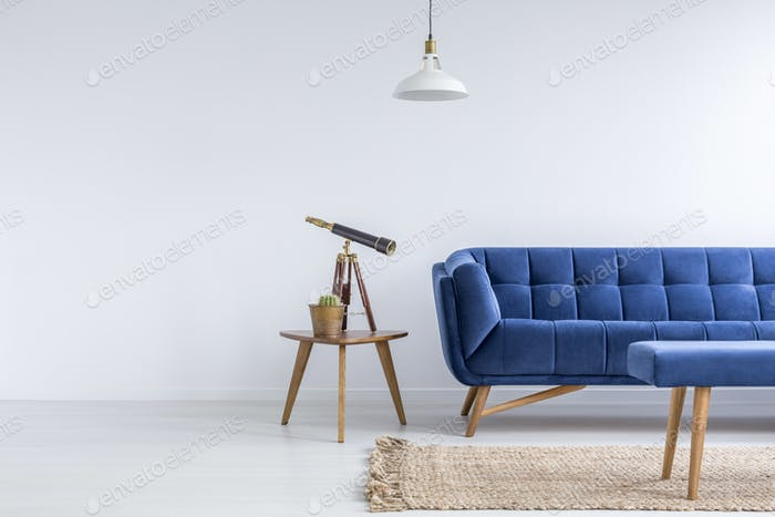 Bright apartment with blue sofa