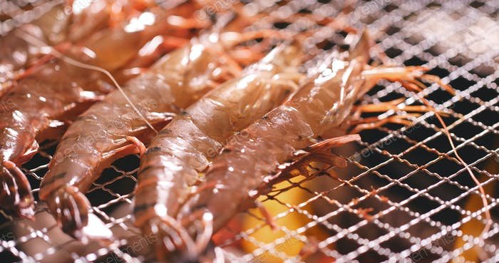 Barbecue with shrimp on metal net