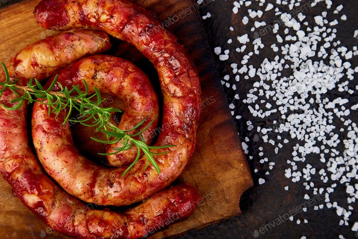 Grilled or Roasted spiral pork sausages with rosemary, salt and peper