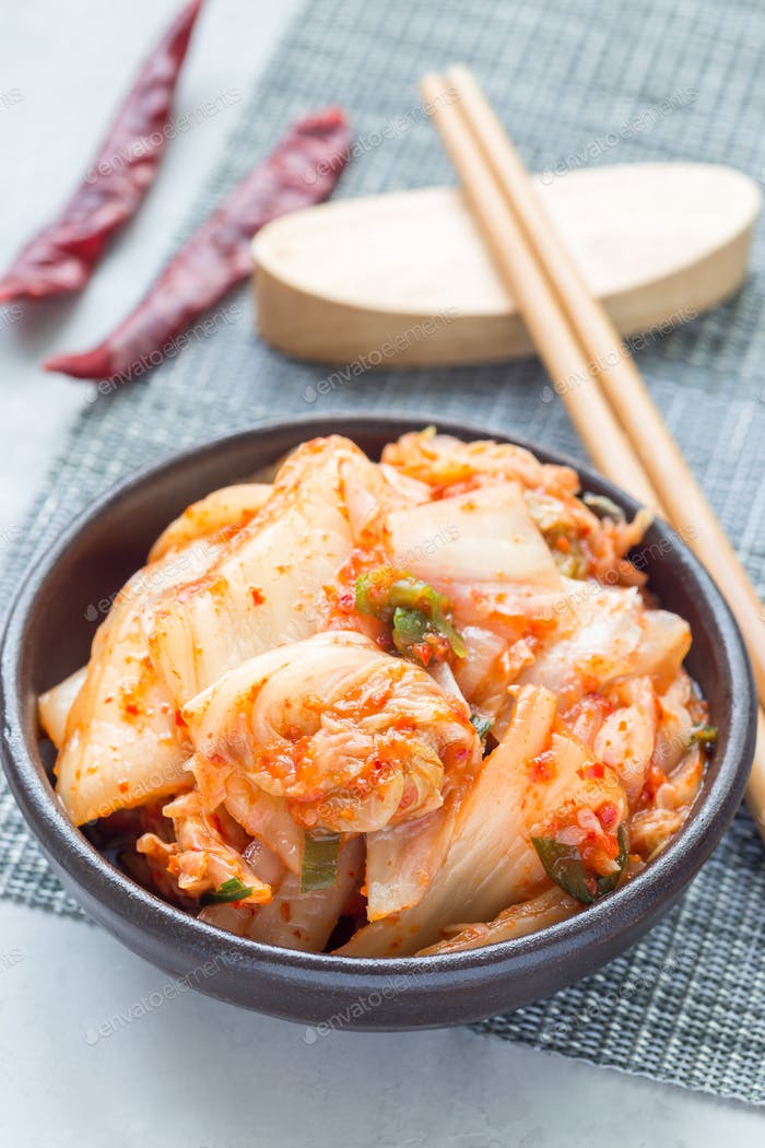 Kimchi cabbage. Korean appetizer in ceramic bowl, vertical
