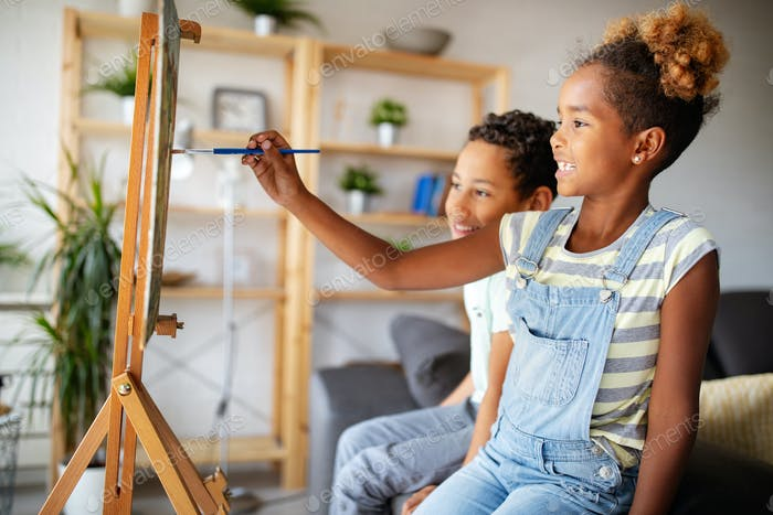Concept of early childhood education, painting, talent, happy kids
