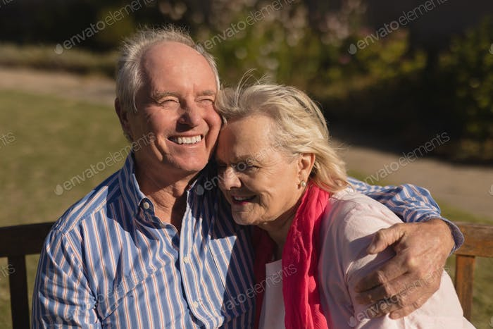 Front view of active senior Caucasian couple embracing each other in the park