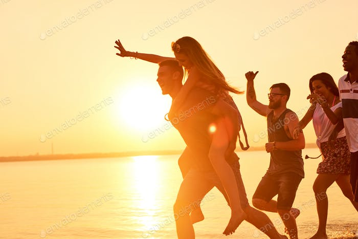 Hilarious friends running on water in light of sunset