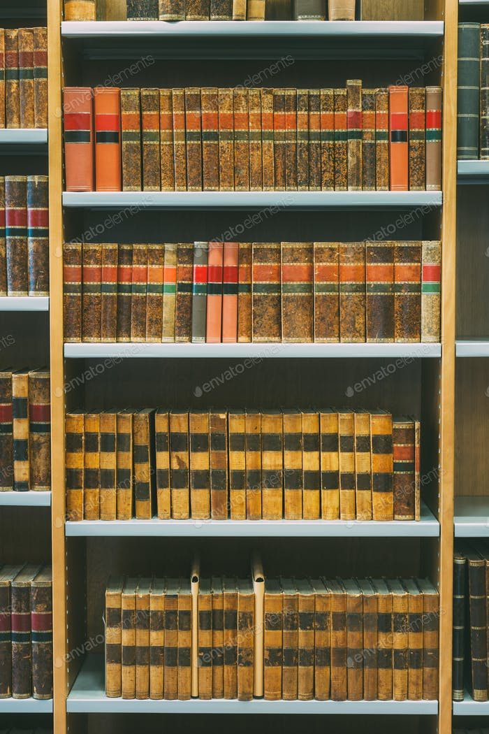 Aged Ancient Antique Old Vintage Books On A Shelfs In Library