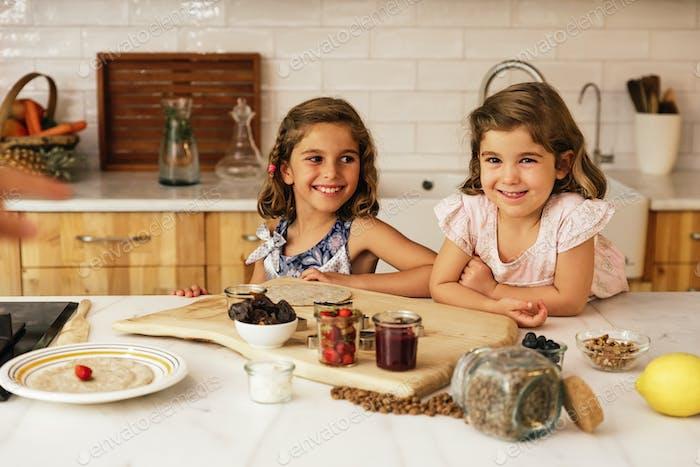 Little sisters girl preparing baking cookies.
