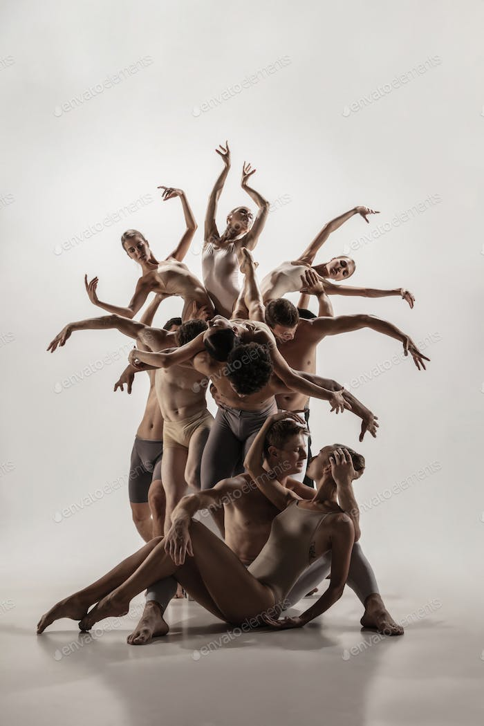 The group of modern ballet dancers. Contemporary art ballet. Young flexible athletic men and women