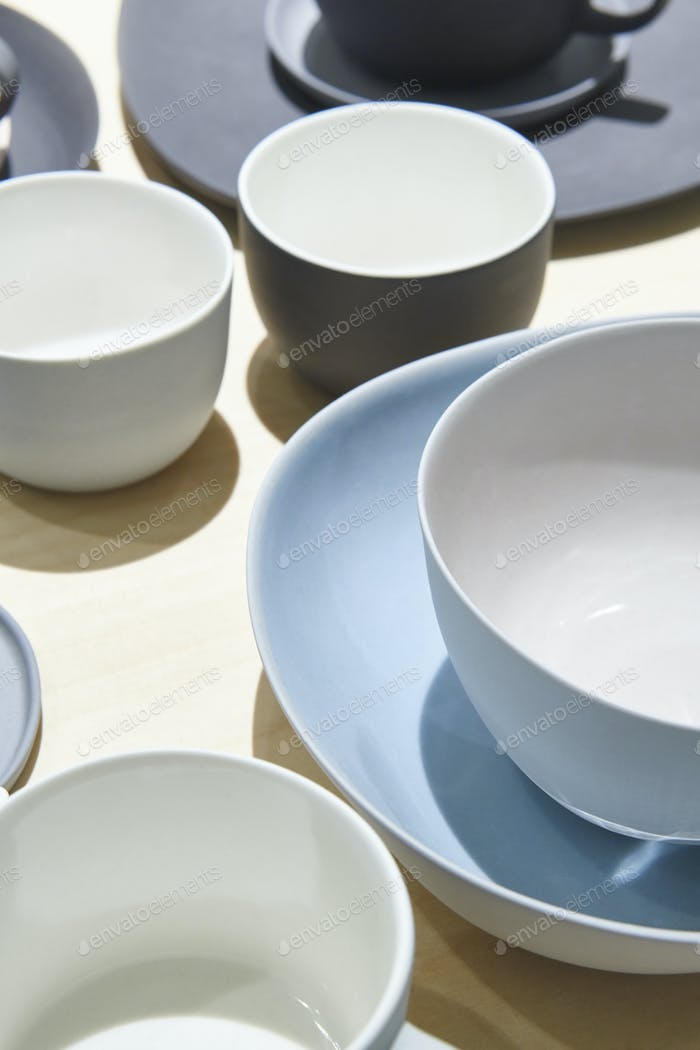 Porcelain cups set on a table. Coffee background. Vertical
