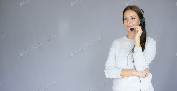 Beautiful and positive female call center agent at work