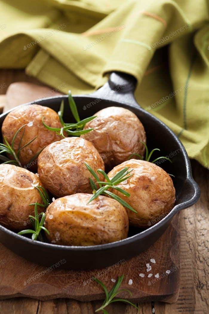 baked potatoes in black pan