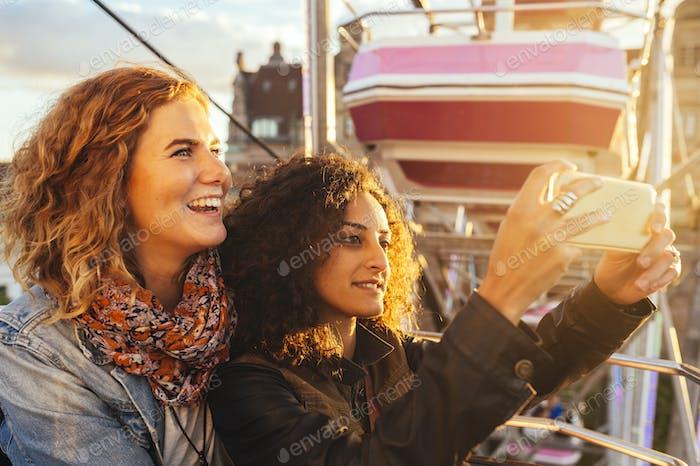 Friends taking selfie during festival