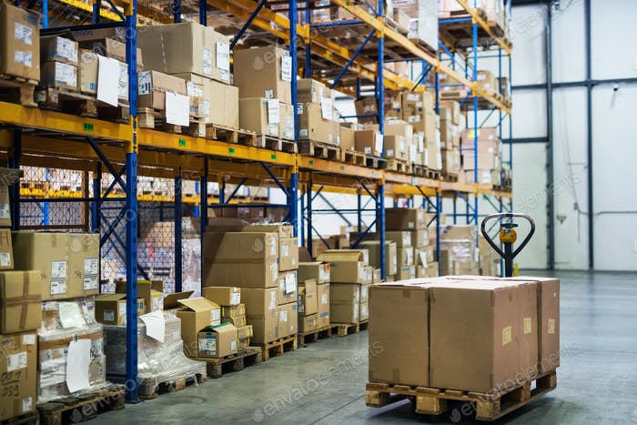 An interior of a warehouse with pallet truck.