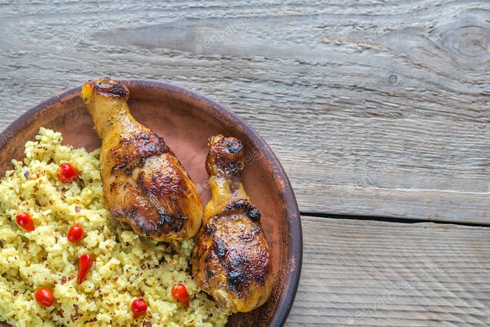Spicy chicken drumsticks with rice curry