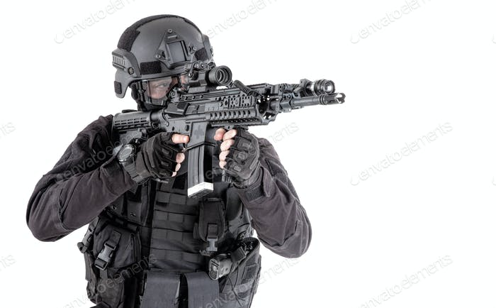 Police SWAT team fighter aiming assault rifle