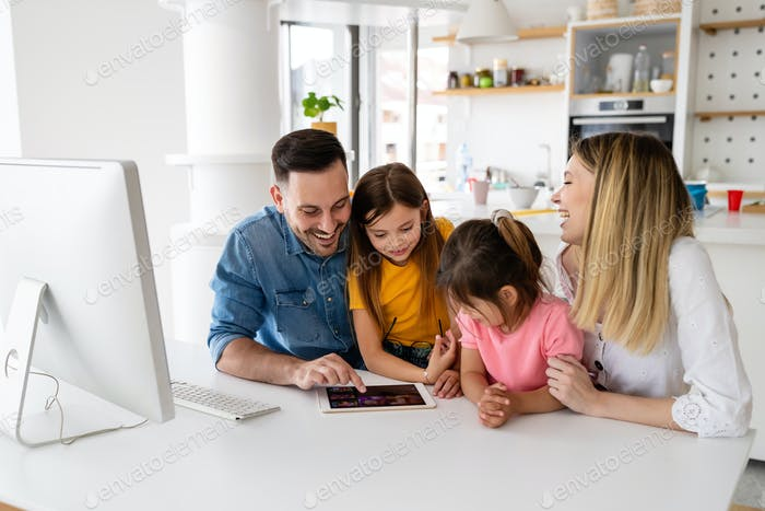 Happy family spending time at home and using digital, technology devices