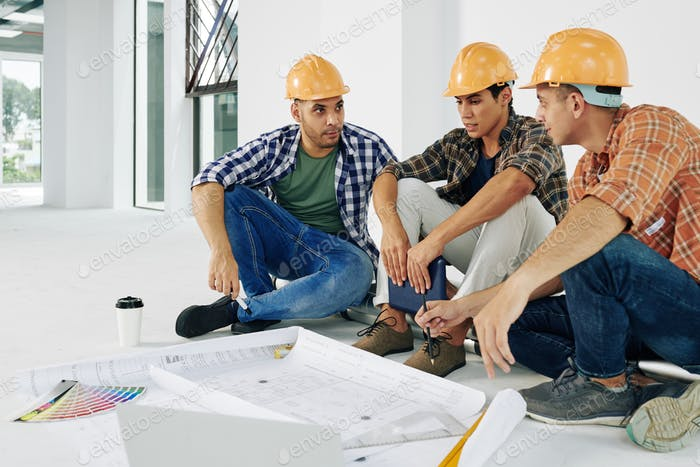 Builders discussing renovations
