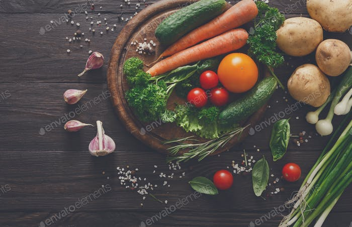 Plenty of fresh vegetables on wooden background with copy space