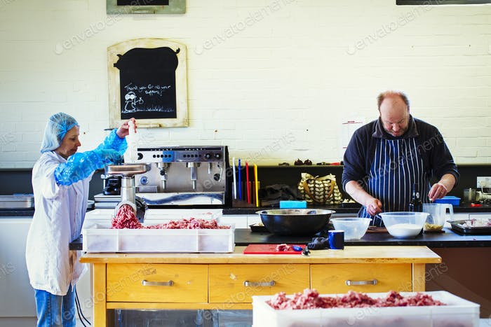 Woman and man in a butchery kitchen
