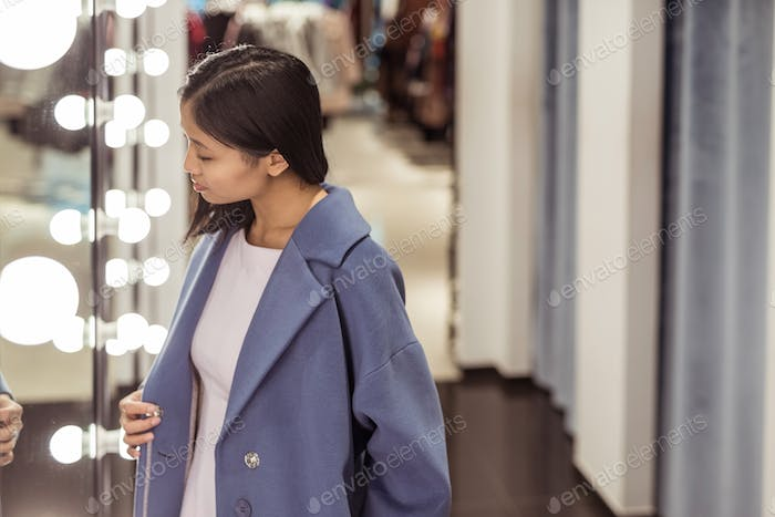 Young beautiful girl in a store