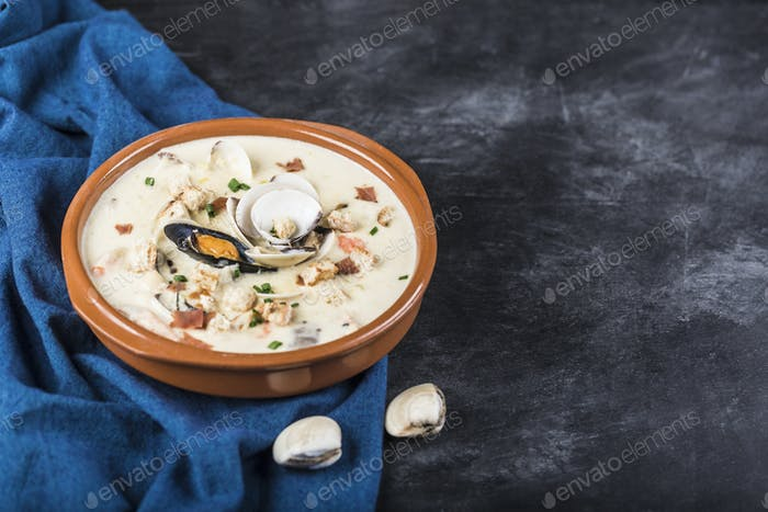 Clam chowder in a brown plate