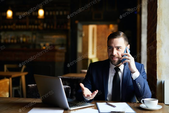 Businessman solving work issues on phone