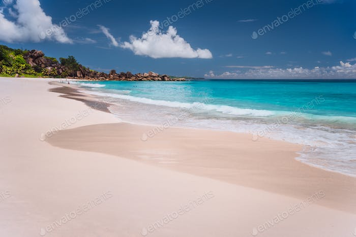 Grand Anse. Long sandy beach with turquoise blue ocean lagoon, La Digue island, Seychelles