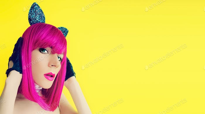 Pussycat lady in bright wig on yellow background glamorous party