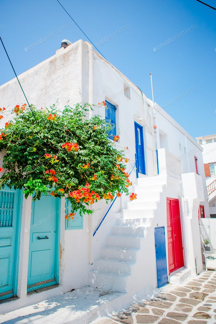 The narrow streets of greek island with trees. Beautiful architecture building exterior with