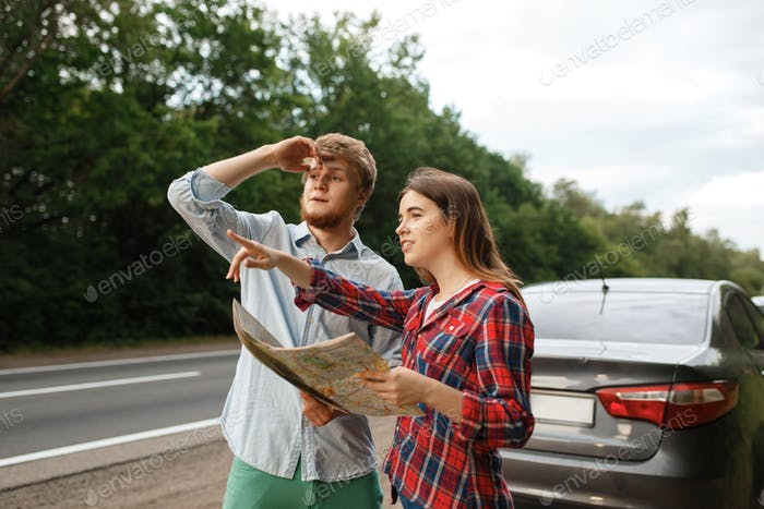 Car tourists with map having quarrel, road travel