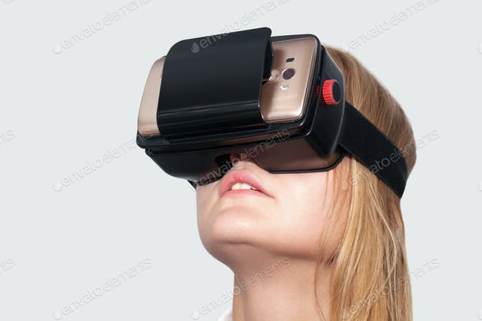 Young woman entertaining with VR-Helmet