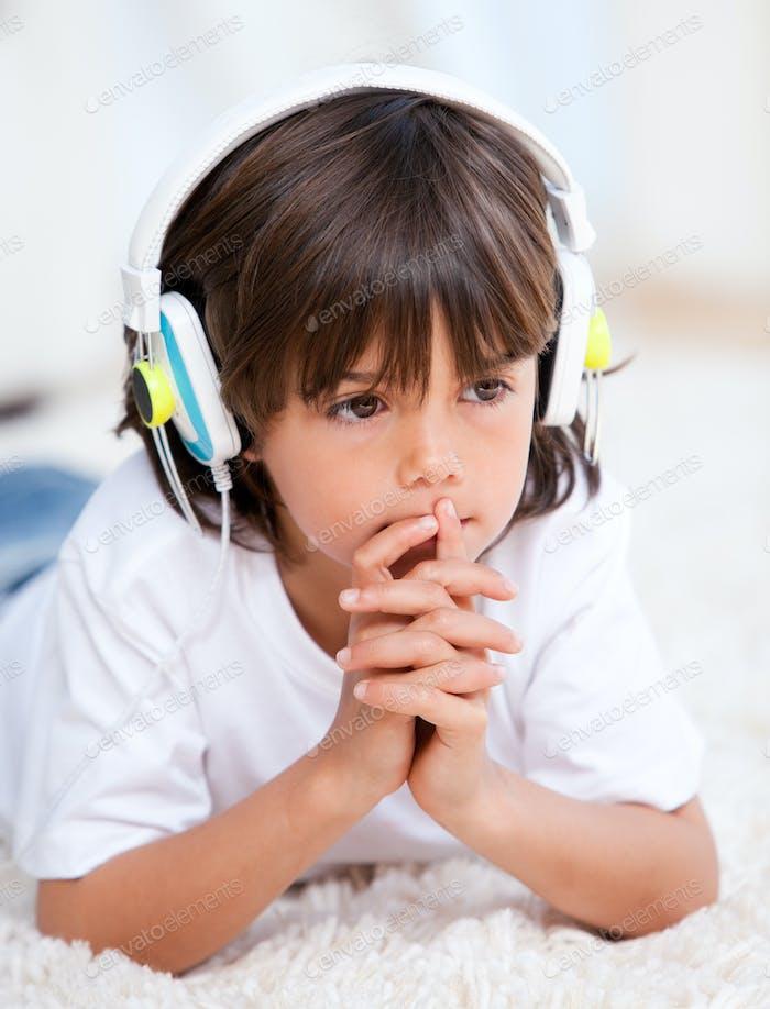 Pensive boy listenning music
