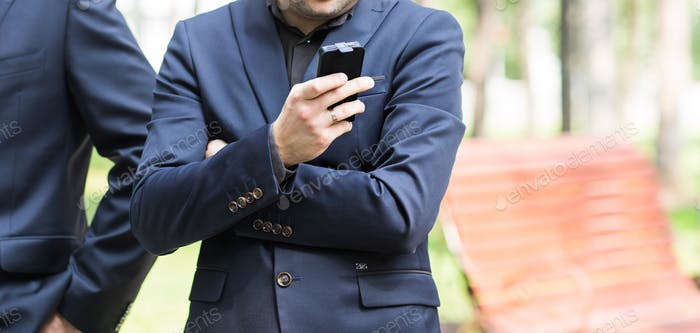 urban professional man using smart phone