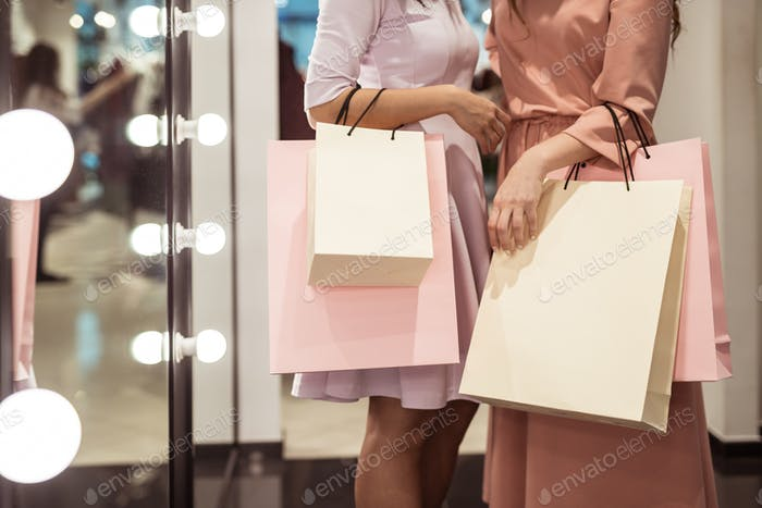 Young girls with shopping bags