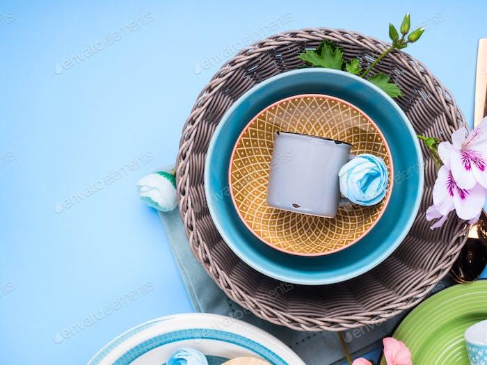 Tableware dish set on blue pastel background