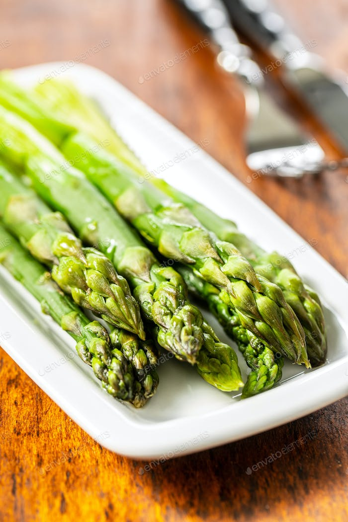 Cooked green asparagus. Healthy seasonal vegetable.