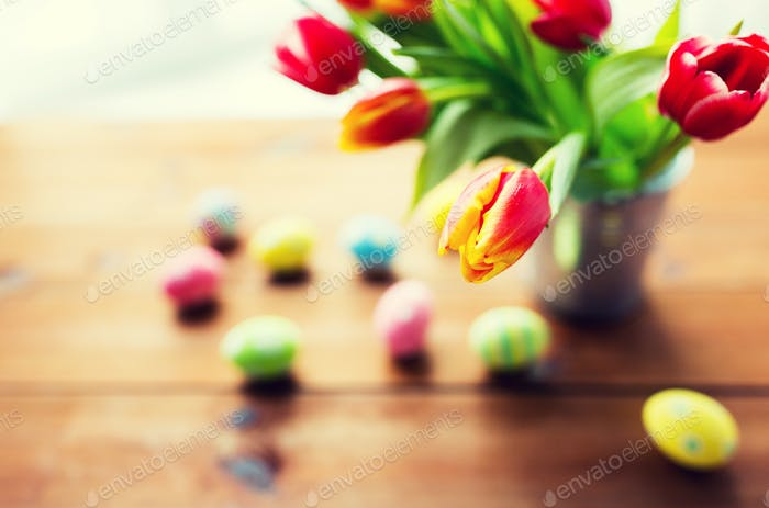 close up of easter eggs and flowers in bucket