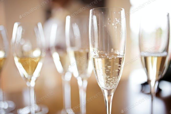 Close up of full champagne glasses at wedding