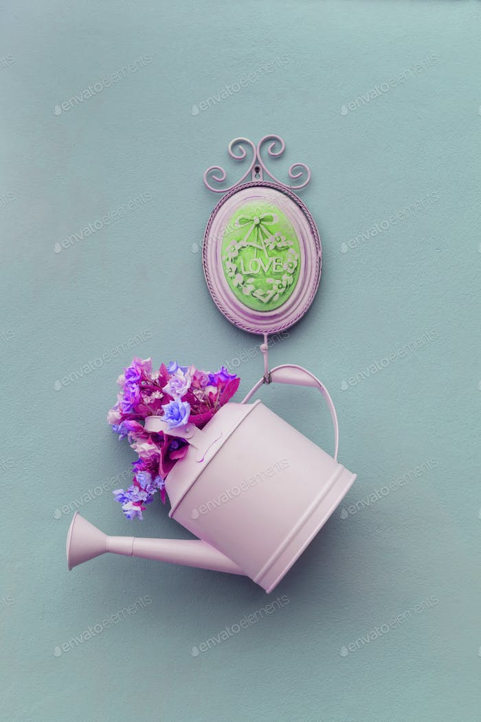 watering can hanging on the vintage wall