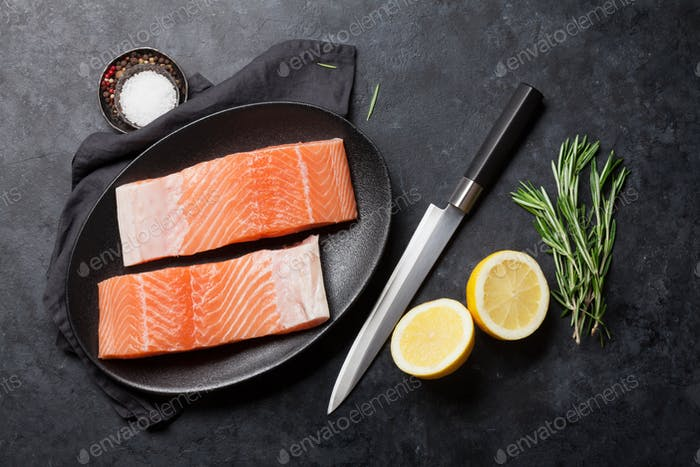 Raw salmon fish fillet and ingredients for cooking